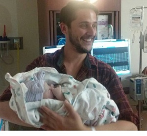 My son Brandon and his new daughter, born yesterday. A joy day for us.