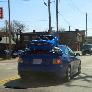 Yes, that's one blue car atop another. Yes, I really drove past this peculiar sight. The extraordinary can be found even along our daily commutes!