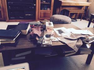 The cluttered desk of an unidentified clergywoman.