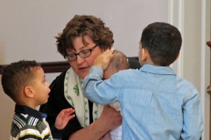 Rev. Kathryn Johnston with some parishioners who are easy to love.