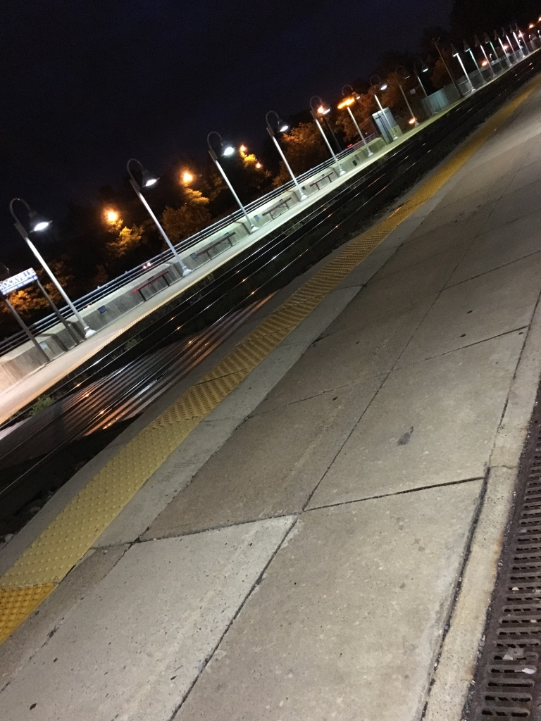 An empty commuter train platform.