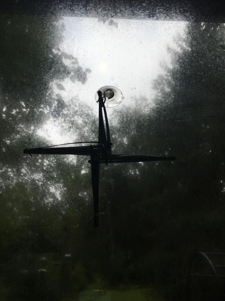 A St . Brigid 's cross on a window on a foggy morning