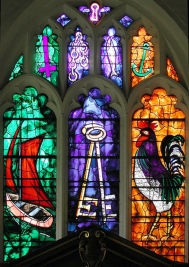 Symbols of St. Peter in Stained Glass. (Key hole, upside-down cross, chain, fish, anchor, boat, keys, rooster)
